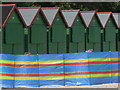 SZ1892 : Mudeford: six beach huts and a windbreak by Chris Downer