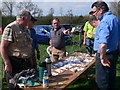SJ1351 : Metal detector enthusiasts discussing their finds on a farm in Pentrecelyn by Eirian Evans