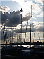 SZ1891 : Mudeford: lamppost and masts by Chris Downer