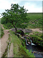 SK0068 : Waterfall and packhorse bridge at Three Shires Head by Graham Hogg