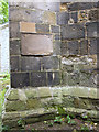 SE9482 : A buttress, a plaque, and a bench mark on All Saints' church by John S Turner