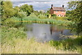 SO9156 : Village pond and cottage, Crowle by Philip Halling