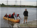 Dist:0.6km<br/>The canoe has come ashore at the water-skiing slipway, on the east side of Connah's Quay, to allow two more volunteers to try it out.