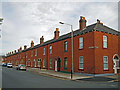 NY4055 : Red brick terraced houses by Richard Dorrell