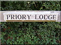 TM2361 : Priory Lodge sign by Adrian Cable