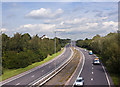 SJ5286 : The A557 from the Bridge at Halton by Ian Greig