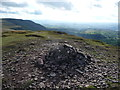 SO2235 : Summit cairn on Twmpa with views towards the Brecon Beacons by Jeremy Bolwell