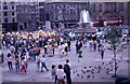 TQ2980 : Tourists in Trafalgar Square (2) by Peter Shimmon