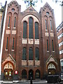 At the junction with Mercer Street. Formerly the Soho Baptist Church