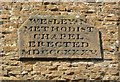 SP7866 : Datestone on the Village Theatre, Moulton by Humphrey Bolton