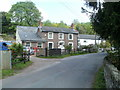 SO3116 : Converted pub and cottages, Llantilio Pertholey by John Grayson