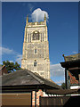 TM2972 : Peeking over the roofs - the tower of All Saints church, Laxfield by Evelyn Simak