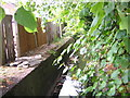 TQ3268 : Norbury Brook at Bensham Close by Christopher Hilton