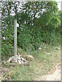 TL6347 : Footpath Sign And Fly Tipping by Keith Evans