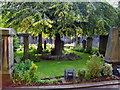 NT2473 : Churchyard garden at St Cuthbert's by Claire M Jordan