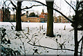 TL4559 : Jesus College and sports field in the snow by John Sutton