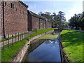 SJ7387 : Dunham Massey Moat and Stable Block by David Dixon