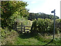 SK9409 : Stile and footpath near Warren Spinney by Ian Yarham