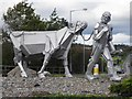 J4040 : Farmer and cow sculpture, Clough by Kenneth  Allen