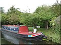 SK6580 : Narrowboat moored alongside small orchard by Christine Johnstone