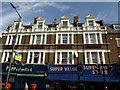 TQ3278 : Shops and facades on Walworth Road by Derek Harper