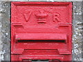 NZ1266 : Victorian postbox, Houghton - aperture by Mike Quinn