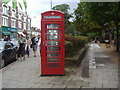 TQ2276 : Red phone box on Church Road, Barnes by David Howard