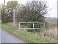 TM0102 : Footpath sign and small bridge over ditch by Roger Jones