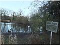 TQ2292 : Sheepwash Pond and sign, The Ridgeway NW7 by Robin Sones