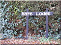 TM3568 : Hare Lodge sign by Adrian Cable