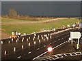 SK7448 : Elston: sunshine and showers on the A46 by Chris Downer