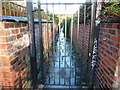 SJ8293 : A gated alley, Chorlton-cum-Hardy by Phil Champion