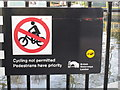 TQ2681 : Paddington Arm - contradictory &quot;Cycling not permitted&quot; sign by David Hawgood