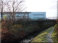 SJ8293 : Buildings at Chorlton High School, and Chorlton Brook by Phil Champion