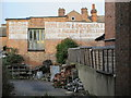 TQ2183 : Former builder's yard with ghost sign, off Crownhill Road, NW10 by Mike Quinn