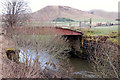NT1135 : Old railway bridge over the Biggar Water by Jim Barton