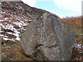 SK0699 : Cut benchmark on a boulder by the Pennine Way by John Slater