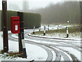 SO8854 : Postbox and snowy lane - Swinesherd by Chris Allen