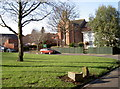 ST5970 : Small green in front of the church by Neil Owen