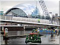 NZ2563 : Clearwater manoeuvres below the Gateshead Millennium Bridge by Andrew Curtis
