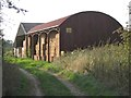 SP1364 : Barns and bales, May's Hill Farm by Robin Stott