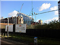 SJ8499 : A new building goes up near Manchester Victoria station by Phil Champion