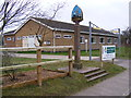 TM4888 : Mutford Village Hall &amp; Village sign by Adrian Cable