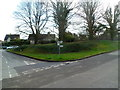 ST9897 : Four trees and four signpost arms at a Kemble crossroads by John Grayson