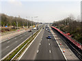 SJ6091 : M62 Motorway at Junction 9 by David Dixon