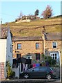 SD9598 : House on the hill above Gunnerside by Christine Johnstone