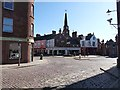 NO3853 : Cobbled square and kirk in the centre of Kirriemuir by Oliver Dixon