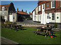 TG0443 : A welcome pint at &quot;The George&quot; at Cley by John Lucas