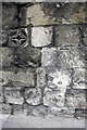 SU1429 : Benchmark and decorative stone on Exeter Street wall by Roger Templeman