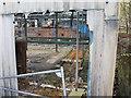 SK2990 : Disused factory at Storrs Bridge by David P Howard